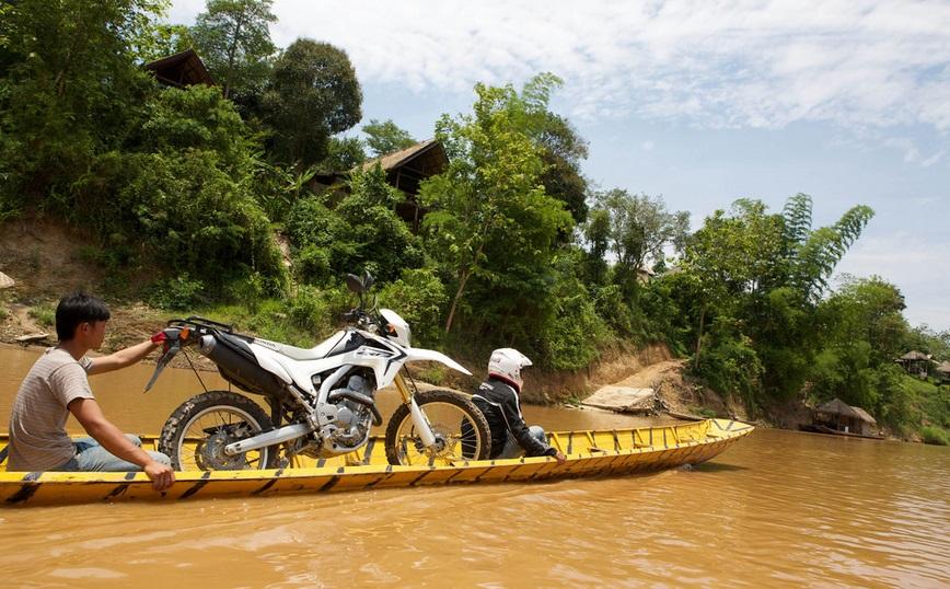 Motorbike Laos on a boat